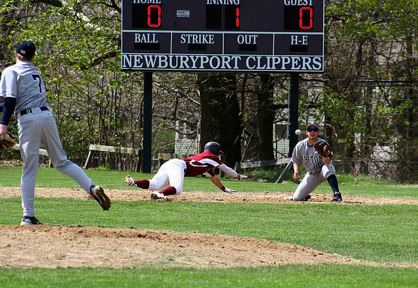 Newburyport: Newburyport's Kyle LeBlanc (7) dives back to first base as Triton's pitcher, Cashman (7) tries to pick him off early in the first inning of Tuesday's game in Newburyport. Photo by Ben Laing/Staff Photo