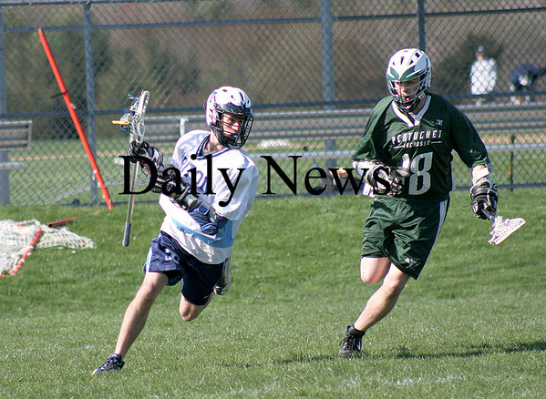 Byfield: Triton's Mike Mantarian (47) evades Pentucket's Joe Lemaitre (18) during Tuesday's lacrosse game in Byfield. Photo by Ben Laing/Staff Photo