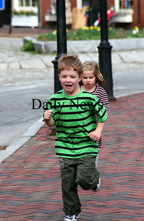 Newburyport: John and Tess Fredette, of Amesbury, race around Market Square in Newburyport Monday afternoon, while spending time downtown with their mom and grandmother. Photo by Ben Laing/Staff Photo