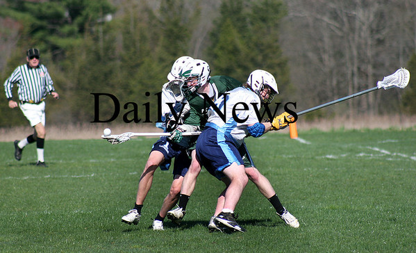 Byfield: Pentucket's Dan Cashman (8) is sandwiched between to Triton players during Tuesday's lacrosse game in Byfield. Photo by Ben Laing/Staff Photo