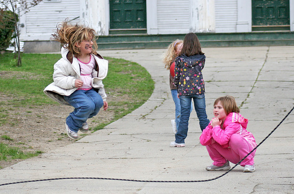 Amesbury: Seven year old Ava Harlow, right, watches as Rachel Shultz, 6, jumps rope outside the Main Street Congregational Church in Amesbury Friday morning. Photo by Ben Laing/Staff Photo