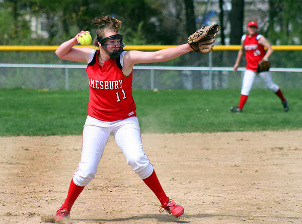 Groveland: Amesbury pitcher, Caroine Merrill (11), delivers a throw to first base after scooping up a ground ball in Wednesday's game at Pentucket. Photo by Ben Laing/Staff Photo