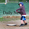 Newbury: Mike Codair, 8, of Newbury, takes a swing during baseball practice at the Upper Green in Newbury Monday night. Photo by Ben Laing/Staff Photo
