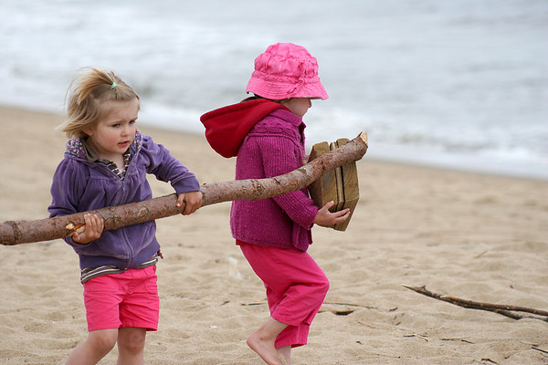 Newbury: Alaina, left, and Layla Burger, right, of Haverhill gather some driftwood while playing on Plum Island Wendesday morning. Photo by Ben Laing/Staff Photo
