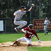 Newburyport: Newburyport's Kyle LeBlanc (7) slides safely into second base while Triton second baseman, D'Agostino (5) leaps to catch an errant throw. Photo by Ben Laing/Staff Photo