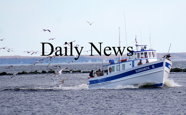 Salisbury: The Sundance II cruises safely into the mouth of the Merrimack River Monday afternoon, escorted by a flock of hungry seagulls. Photo by Ben Laing/Staff Photo