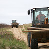 Newburyport: Newburyport's Department of Public Service crews use their machinery to help clean the beach at Plum Island point Tuesday afternoon. Photo by Ben Laing/Staff Photo