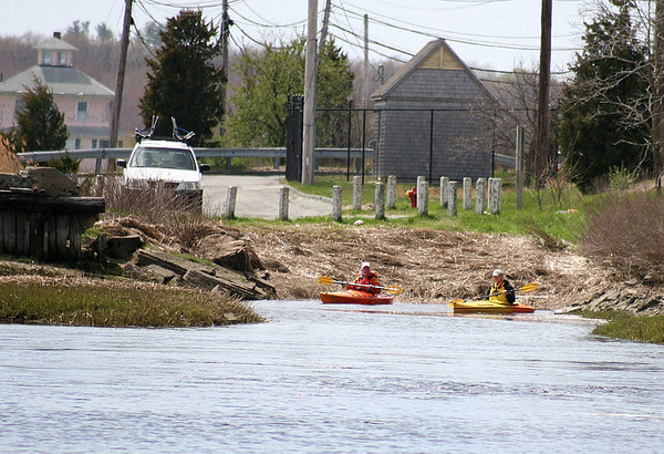 Newburyport: A pair of kayakers embark from the foot of the Donald Wilkinson Memorial Bridge of Plum Island Tuesday afternoon. Photo by Ben Laing/Staff Photo