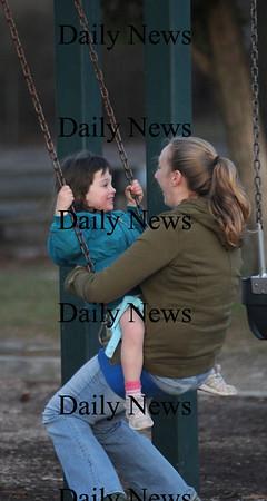 Newburyport: Lilly Brunnick, 3, rides the swing at ayers Park in Newburyport with her nanny Amanda Schena Thursday faternoon. Jim Vaiknoras/Staff photo