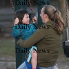 Newburyport: Lilly Brunnick, 3, rides the swing at ayers Park in Newburyport with her nanny Amanda Schena Thursday faternoon. Jim Vaiknoras/Staff photo