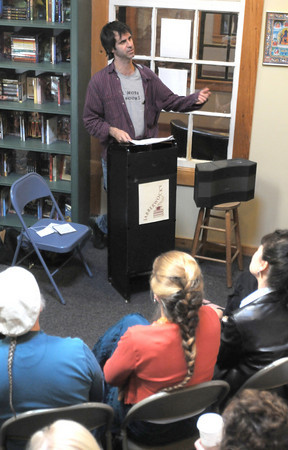 """Newburypor: Steve Almond, author of """" Rock and Roll will Save your Life, talks about how Rock and Roll saved his life at Jabberwocky in Newburyport Saturday. The event was part of the annual Newburyport Literary Feastival. Jim Vaiknoras/Staff photo"""