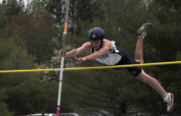 Byfield: Triton's John Mirandi clears the bar on the pole vault during the Vikings meet against North Andover MOnday. Jim Vaiknoras/Staff photo