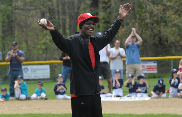 """Byfield: Former Red Sox pitcher Dennis """"Oil Can"""" Boyd greets the crowd at Opening Day at the Martha Pearson Field in Byfield Sunday morning. jim Vaiknoras/Staff photo"""