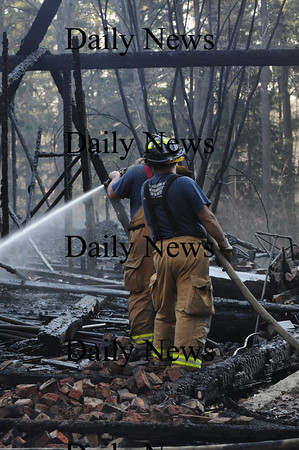Newburyport: Firefighters hose down the fire at the horse barn in Maudslay Sate Park Saturday afternoon. Jim Vaiknoras/Staff photo