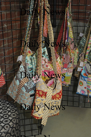 "Amesbury: Kim Pauley with her pocketbooks at her studio ""Justkim Design"" on Cedar Street in Amesbury. Jim Vaiknoras/Staff photo"