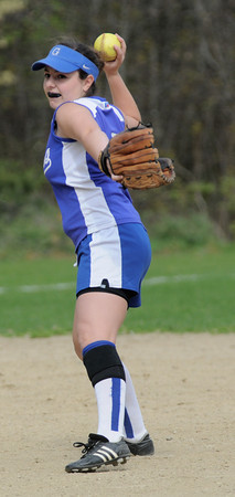Georgetown: Georgetown's  Amy Cronin tosses the ball to first during the Royal's game against Amesbury Monday. .Jim Vaiknoras/Staff photo