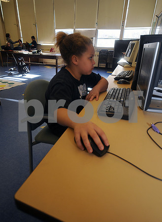 Salisbury: Jaida Timmons, 8, of Salisbury uses one of the many computers at the Boys and Girls Club in Salisbury Thursday night. Jim Vaiknoras/Staff photo