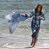 Salisbury: Mercedes Belanger of Littleton NH enjoys a warm Saturday afternoon kite flying on Salisbury Beach. Jim Vaiknoras/Staff photo