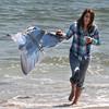 Salisbury: Mercedes Belanger of Littleton NH enjoys a warm Saturday afternoon kite flying on Salisbury Beach. Jim Vaiknoras/Staff photo