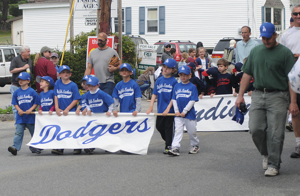 Byfield: Member of the Byfield/Newbury Little League make their way down Main Street  for Opening Day at the Martha Pearson Field in Byfield Sunday morning. jim Vaiknoras/Staff photo