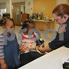 Merrimac: Merrimac EMT Gretchen Nolan takes the blood pressure of sistersd Bella,4, and Ginevra, 3, Muniu at Saturday health fair at the senior Center in Merrimac. Jim Vaiknoras/Staff photo