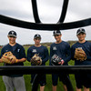 Byfield:Triton pitchers Blaise Whitman, Tim Cashman, Cam D'Agostino, and Tom Kuczun pose at their prctice at Triton Friday. Jim Vaiknoras/Staff photo
