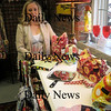 "Amesbury: Kim Pauley with her pocketbooks at her studio ""Justkim Design"" on Cedar Street in Amesbury. Jim Vaiknoras/Staff photo"