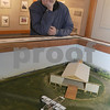 Newbury: Bruce Carter lookso ver a diorama he built with Ted Russell of  the airfield  in Burgess Aviation Museum at the Plum Island airportas it would have looked in 1910. They will be celebrating the 100th anniversary of the first flying field in New England there on April 17th.<br /> <br /> . Jim Vaiknoras/Staff photo