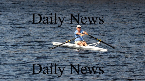 Amesbury: A rower soaks up some warm sunshine as he glides along Lake Gardner in Amesbury Sunday afternoon. Jim Vaiknoras/Staff photo