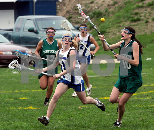 Georgetown: Pentucket's Stephanie Fitzgerald fights for teh ball with Georgetown's Michelle Reilly during their game at Georgetown Thursday afternoon. Jim Vaiknoras/Staff photo
