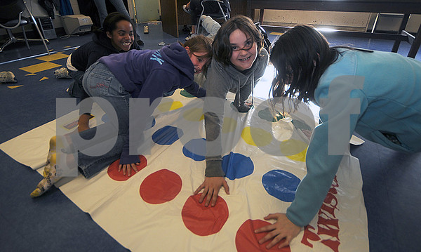 Salisbury: Rosali Cabrera, Hailee Clogston, Talia Corey and Alisha Clogston play a game of Twister  at the Boys and Girls Club in Salisbury Thursday night. Jim Vaiknoras/Staff photo