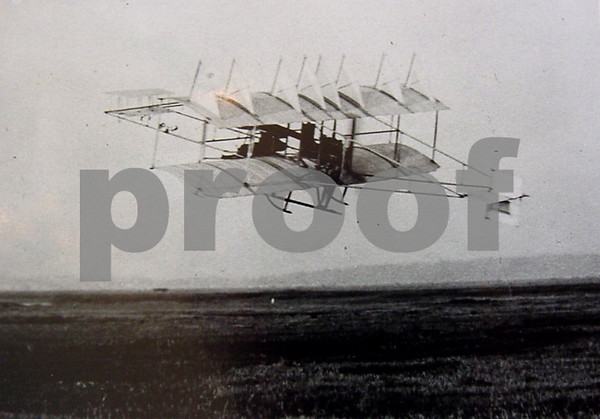 Herring-Burgess #2 biplane in flight, with view toward Newbury to the west over the marsh, April 1910.