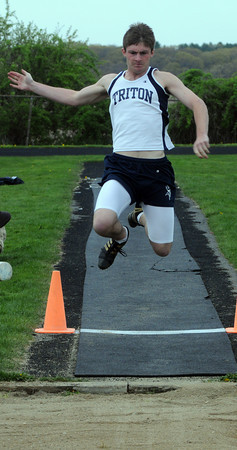 Byfield: Triton's jared White competes in the long jump during the Vikings meet against North Andover MOnday. Jim Vaiknoras/Staff photo
