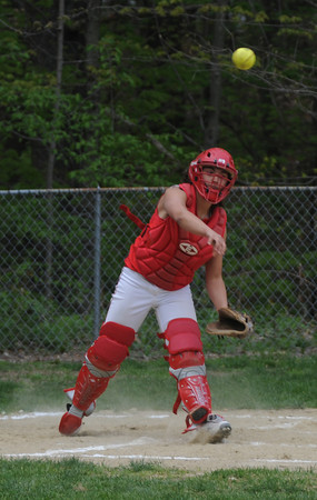 Georgetown: Amesbury's Laura Kaminski tries to throw out a runner at first during the Indian's game monday at Georgetown.Jim Vaiknoras/Staff photo