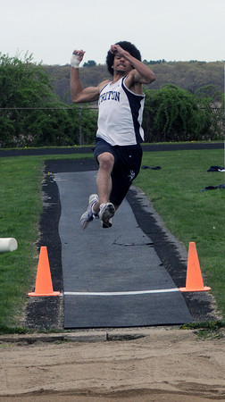 Byfield: Triton's Terrance Carter competes in the long jump during the Vikings meet against North Andover MOnday. Jim Vaiknoras/Staff photo