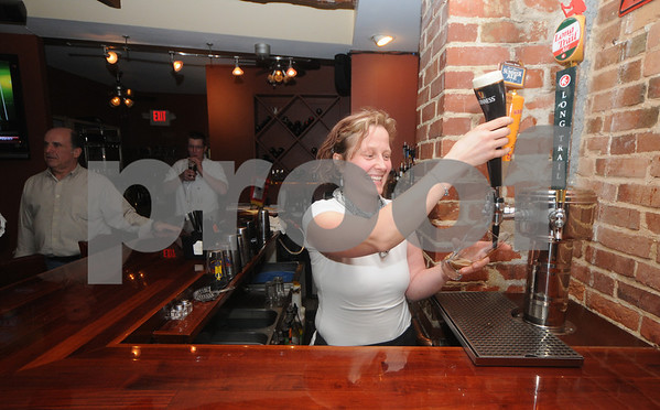 Newburyport: Katy Sutton Brown pours a Guinness at Loretta's on State Street in Newburyport. Jim Vaiknoras/Staff photo