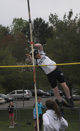 Byfield: Triton's Ben Collins clears the bar on the pole vault during the Vikings meet against North Andover MOnday. Jim Vaiknoras/Staff photo