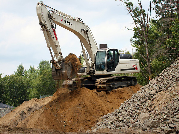 Newburyport: An excavator works at the Crow Lane Landfill in Newburyport Monday afternoon. Photo by Ben Laing/Staff Photo