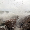 Newbury: The rocks at Plum Island center were pummeled by waves Monday morning as a nor'easter rolled through the region. Photo by Ben Laing/Staff Photo