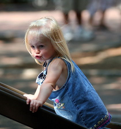 Newburyport: Kay See, 1, of Newburyport, tries to scale the slide at the tot lot on Inn Street Monday afternoon. Photo by Ben Laing/Staff Photo