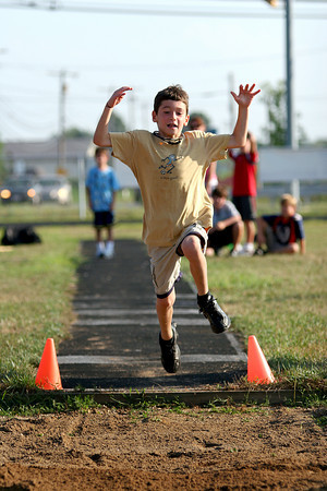 Newburyport: Joshua Imbornone, 8, of Middleton, competes in the long jump event at Tuesday's Winner's Circle Grand Prix youth track meet in Newburyport. Photo by Ben Laing/Staff Photo