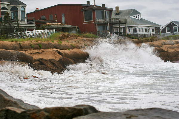 Newbury: Waves smash into the sandbags at Plum Island Tuesday afternoon, which have suffered severe damage during the nor'easter Monday night. Photo by Ben Laing/Staff Photo