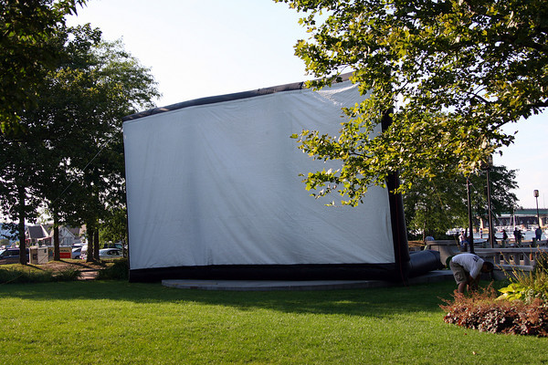 "Newburyport: A worker sets up a 40 foot inflatable movie screen at Market Landing near the waterfront in Newburyport Wednesday afternoon. The city's chamber of commerce is showing family movies every Wednesday evening with this week's ""The Fantastic Mr. Fox"" gracing the silver screen. Photo by Ben Laing/Staff Photo"