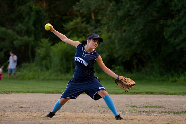 Rowley: Triton pitcher, Alexa Reilly (10) delivers during Wednesday night's U14 softball game against Ipswich. Photo by Ben Laing/Staff Photo
