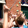 "Newburyport: A barrage of Cookie Monster cupcakes fly into the crowd gathered outside of Pralines and Pepper in downtown Newburyport, as the store was shooting a audtion tape for the upcoming Food Network show, ""Cupcake Wars"". Photo by Ben Laing/Staff Photo"