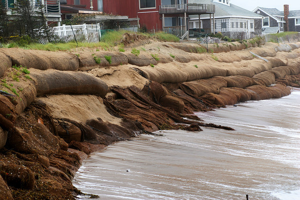 Newbury: The sand bags at Plum Island were severely damaged by the nor'easter Tuesday, as the high waves continued to pound the beach. Photo by Ben Laing/Staff Photo