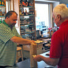 Amesbury: Dicky Capena, an employee of Rt. 110 Liquors in Amesbury, sells a bottle of wine to a customer Wednesday afternoon. The store is expecting a pick up in business during this weekends sales tax holiday. Photo by Ben Laing/Staff Photo