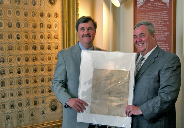 Newburyport: Mark Guay and Richard Eaton display the original by-laws of the Newburyport Marine Society Monday at the Custom House. Photo by Ben Laing/Staff Photo