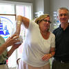 Newburyport: John Ashton holds a jar full of entries for the Yankee Homecoming 50/50 raffel, as Ann Ormand reaches in to pull out a name. The pair are joined by Don Walters, right, the General Chairman of Yankee Homecoming. The winner, Susan O'Rourke of Newburyport, took home $3210.00. Photo by Ben Laing/Staff Photo