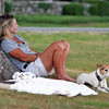 Newbury: Mary Beth Harris of Prince Edward Island, and her Jack Russell Terrier, China Doll, relax in the shade of a tree at the Newbury Green Monday afternoon. The pair were visiting the area while staying in Ipswich for the summer. Photo by Ben Laing/Staff Photo